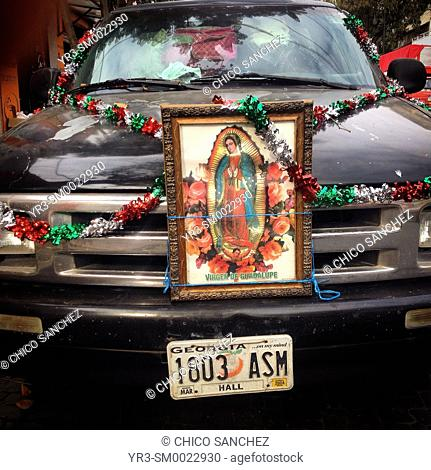 A car decorated with the image of Our Lady of Guadalupe during the annual pilgrimage to the Basilica of Our Lady of Guadalupe in Mexico City, Mexico