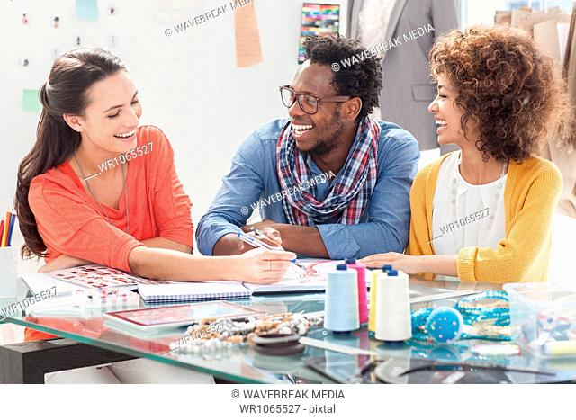 Cheerful fashion designers working together