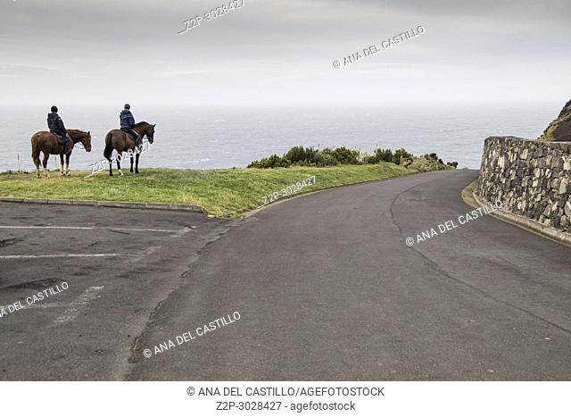 Couple by horse in Sao Miguel island. Azores, Portugal. Pico Camarinhas viewpoint