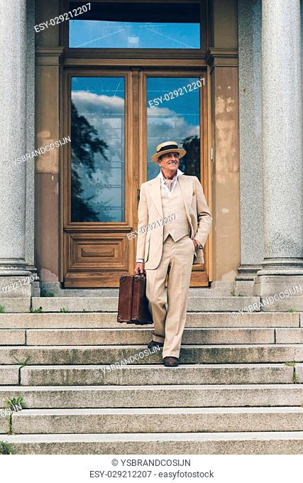 Vintage commercial traveler walking down stairs at front door