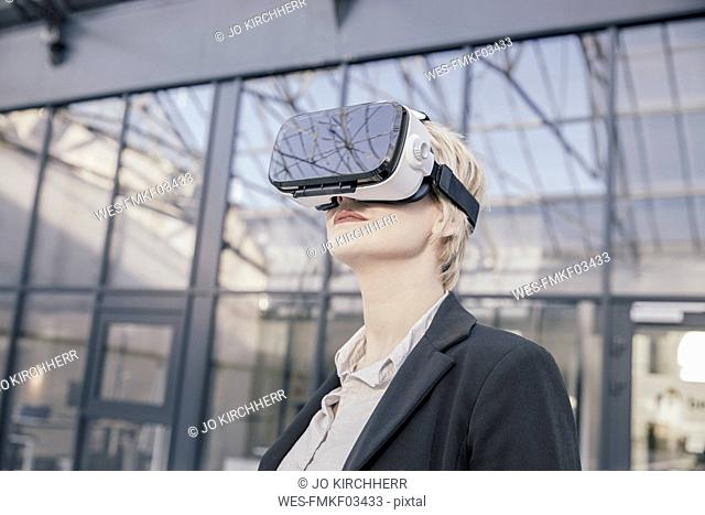 Businesswoman using Virtual Reality Glasses