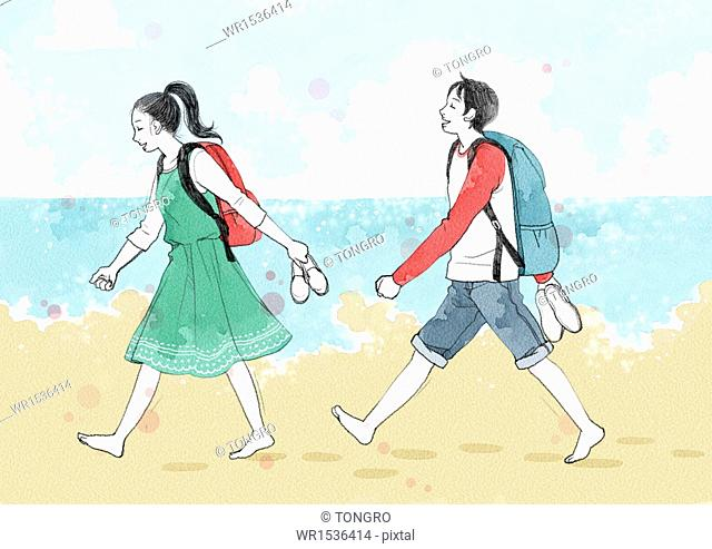 a couple walking on the beach without shoes