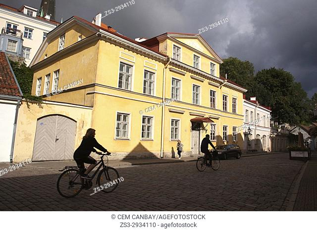 Silhouettes of a couple riding on bikes in the streets of the old town,Tallinn, Estonia, Baltic States, Europe