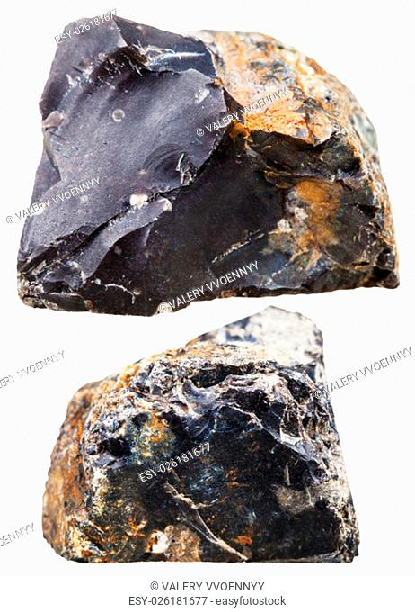 macro shooting of natural mineral stone - two pieces of black flint (chert) rock isolated on white background
