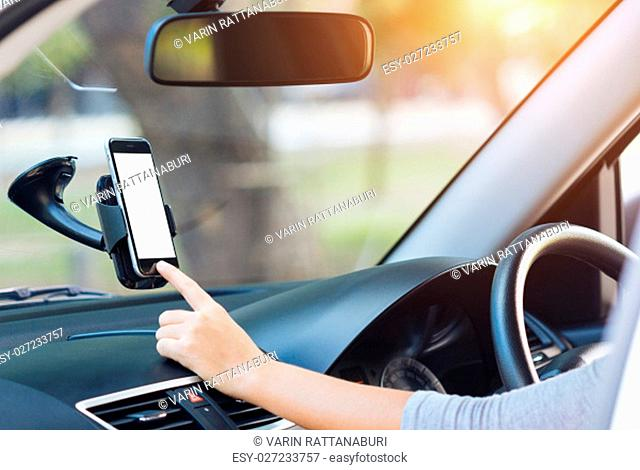 hand touching on phone mobile white screen in car