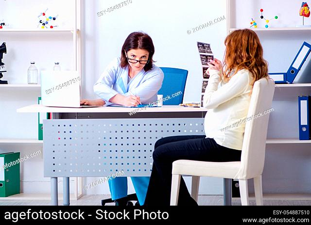 Young pregnant woman visiting experienced doctor gynecologist