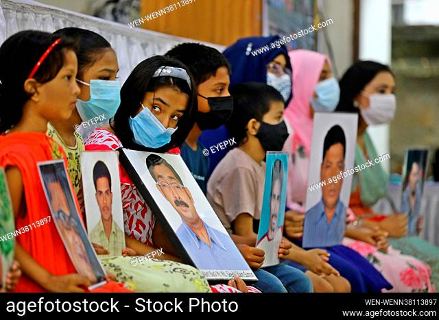 Children hold pictures of their relatives missing during the International Day of the Victims of Enforced Disappearances on August 30th 2021 in Dhaka