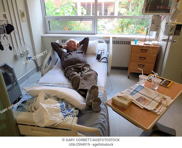 A senior man lying on a hospital bed, well and ready to leave