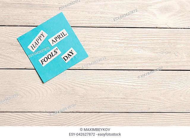 April Fools Day printed phrase on wooden background