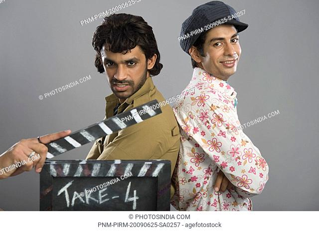 Actors portraying Gabbar Singh and Dev Anand on a movie set