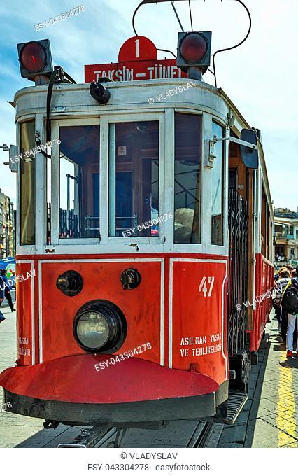 ISTANBUL, TURKEY - MAY 05, 2014: Red nostalgic tramways T2 line, Galatasaray Tram Taksim Istiklal Street. Istanbul, Turkey
