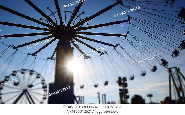 Amusement ride at twilight at summer fair in Windsor, Maine