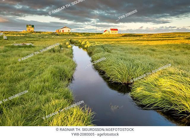 Marshland and summer houses, Flatey Island, Borgarfjordur, Iceland