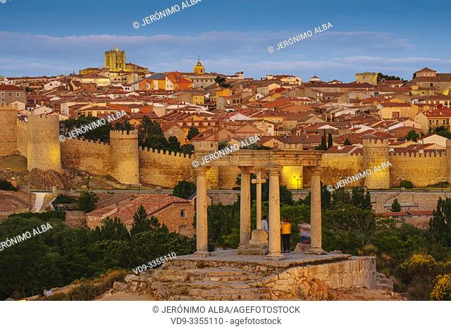 Medieval monumental walls and the four posts monument at sunset, UNESCO World Heritage Site. Avila city. Castilla León, Spain Europe