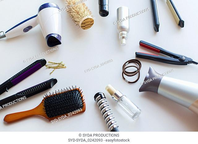 hairdryers, irons, hot styling sprays and brushes