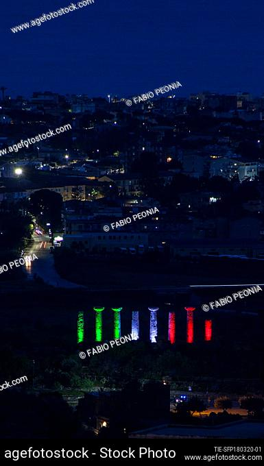 A view of Temples Valley lighting with the colours of Italian flag in Agrigento , ITALY-18-03-2020