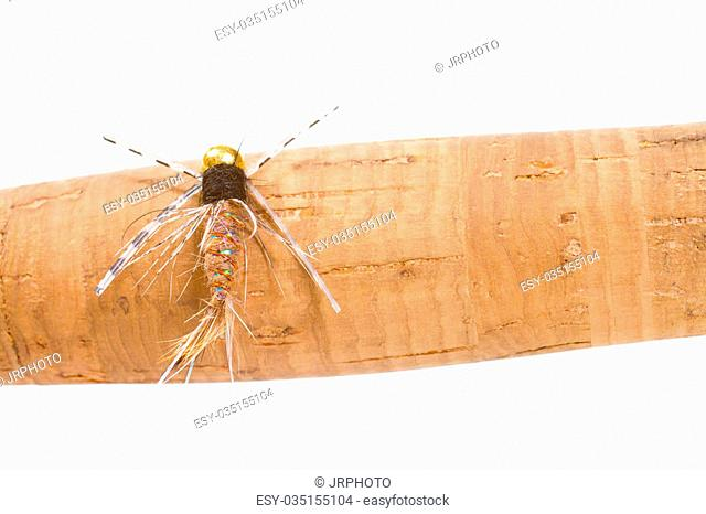 This big fly fishing fly is isolated on a cork handle in the studio for a detail fly fishing color image