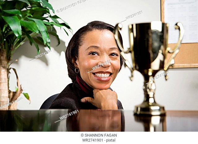 Business woman admiring her trophy