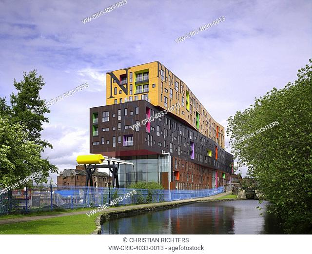 Oblique elevation with canal. Chips, Manchester, United Kingdom. Architect: Alsop, 2012