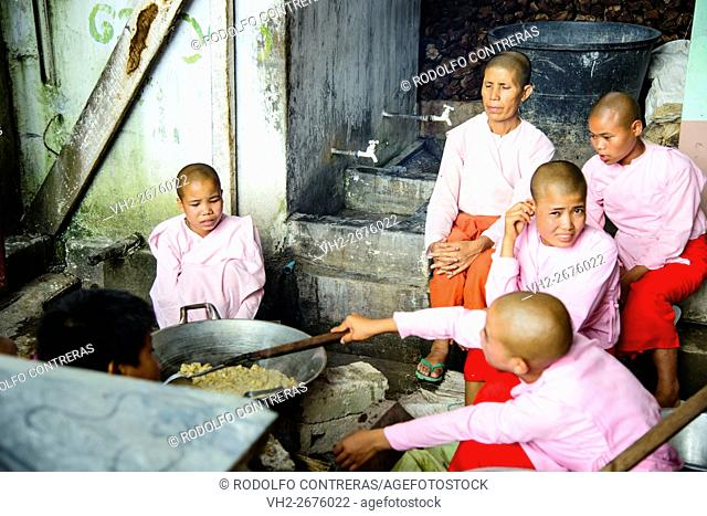 Nuns cooking at the nunnery in Nyaungshwe, Myanmar