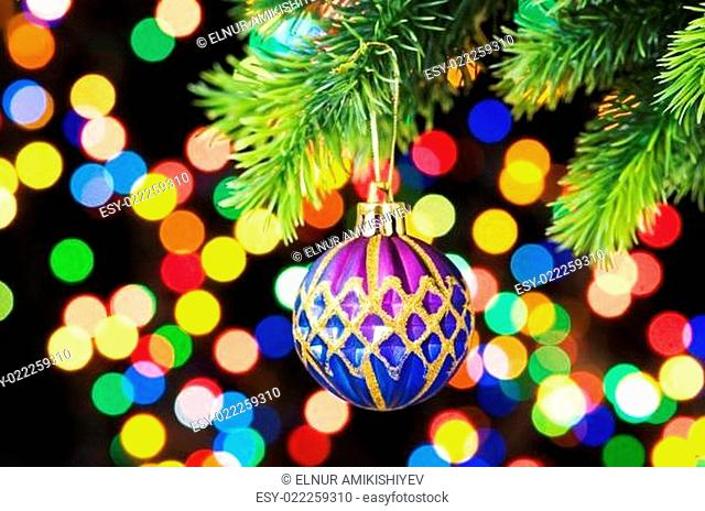 Christmas decoration and blurred lights at background
