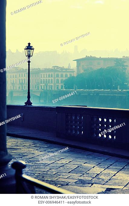 "View of the embankment morning in Florence .Photo executed in a range of """"cross processing"""""
