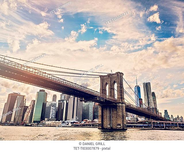 Brooklyn Bridge over Hudson River with Financial district in background