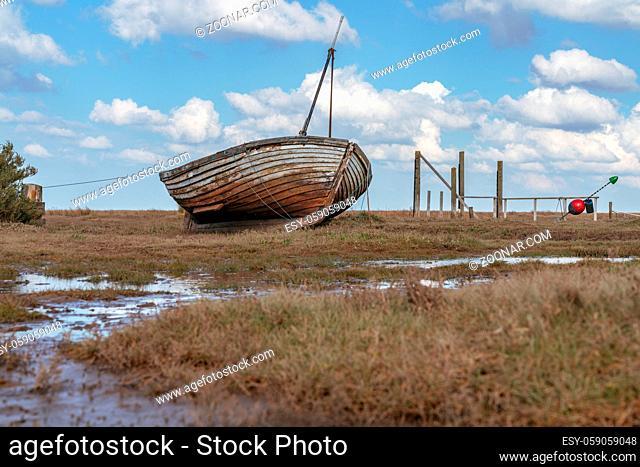An old wooden sailing boat in Thornham Old Harbour, Norfolk, England, UK