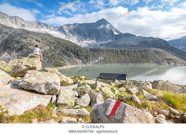Hicker admire the Adamello Mount and Garibaldi refuge. Temù, Val d'Avio (Adamello Park), Brescia province, Lombardy, Italy, Europe