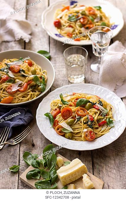 Spaghetti with cherry tomatoes, fresh basil, olives, chilli and parmesan
