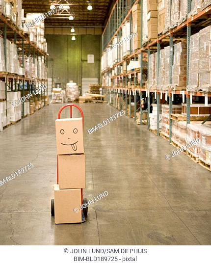 Stack of boxes in warehouse with smiley face