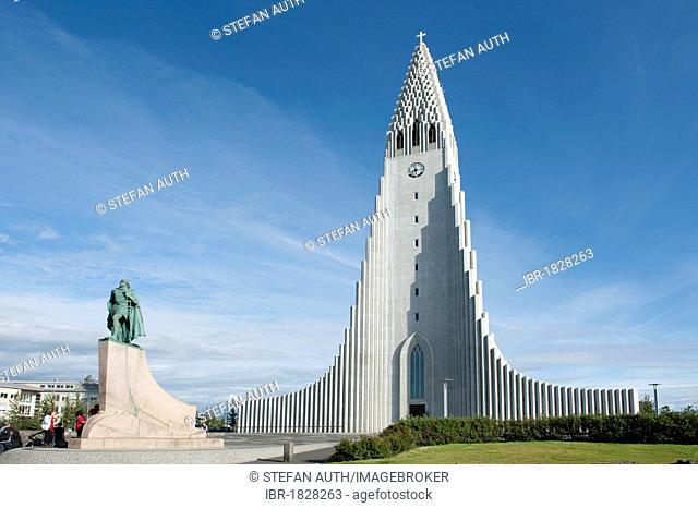 Statue of Leif Ericson, Leifur Eiríksson, in front of the high steeple of the Lutheran Hallgrímskirkja parish church, town centre, Reykjavik, Iceland