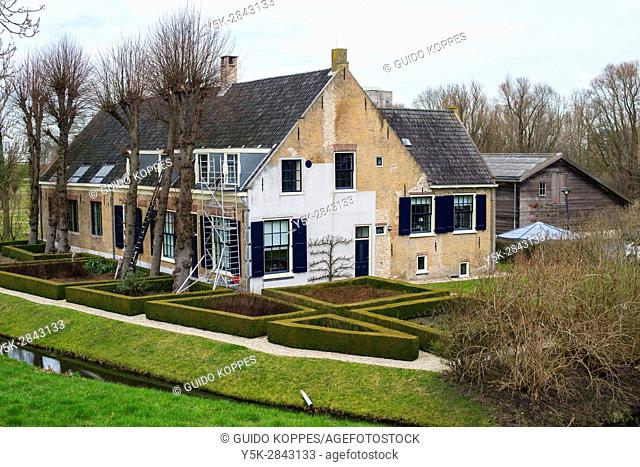 Rotterdam, Netherlands. Old Dike House inside a Park at the banks of Nieuwe Maas River