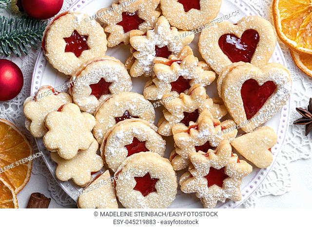 Linzer Christmas cookies arranged on a plate
