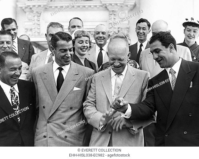 President Eisenhower with baseball great Joe DiMaggio, and boxing champion, Rocky Marciano. June 6, 1953. They were among 45 sports champions invited to attend...
