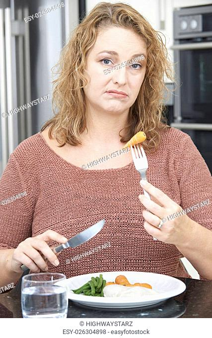 Woman On Diet Fed Up With Eating Healthy Meal