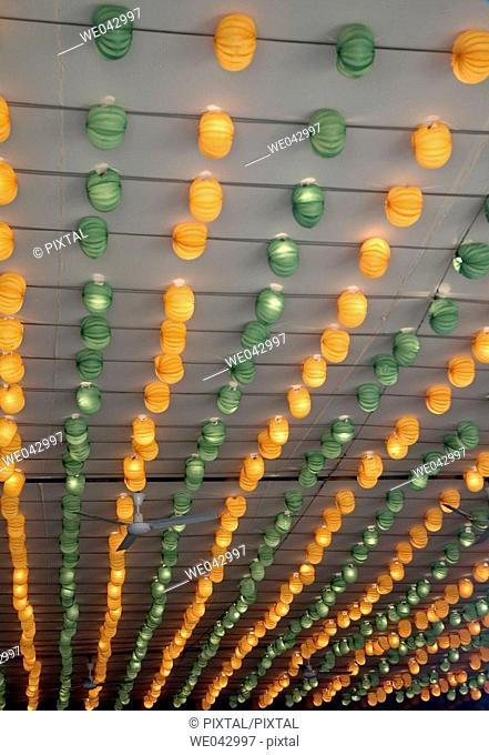 orange and green lanterns fair booth
