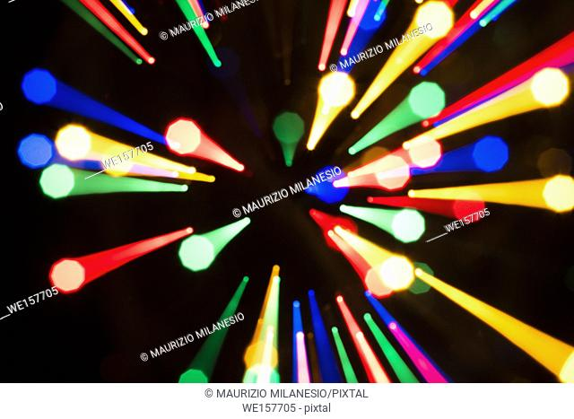 Trails of multicolored radial lights blurred on black, can use background