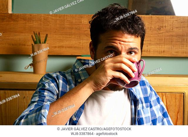 young man drinking coffee with casual clothes
