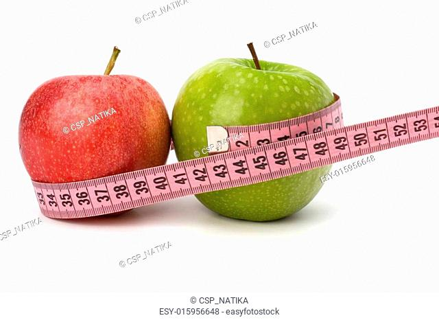 Apple with tape measure. Healthy lifestyle concept