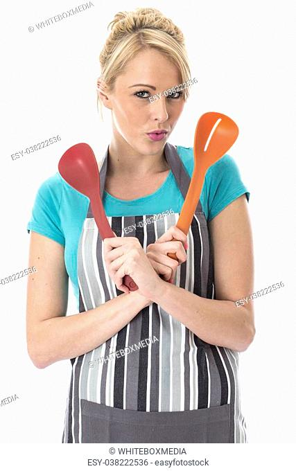 Model Released. Attractive Young Woman Holding Plastic Serving Spoons