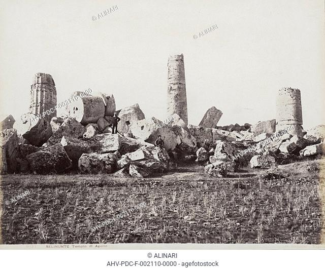The remains of the Temple of Apollo in Selinunte. Two male figures can be seen on the collapsed columns, shot 1885 ca. by Sommer, Giorgio