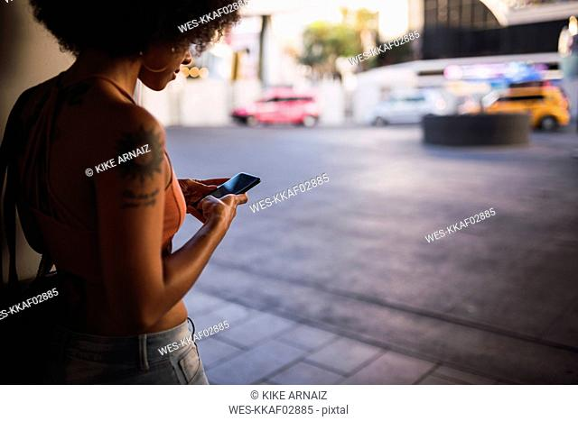 USA, Nevada, Las Vegas, young woman using cell phone in the city