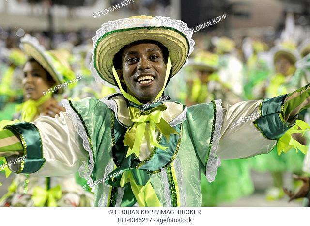 Smiling dancer, parade of the samba school Acadêmicos do Grande Rio, Carnival 2016 in the Sambodromo, Rio de Janeiro, Brazil