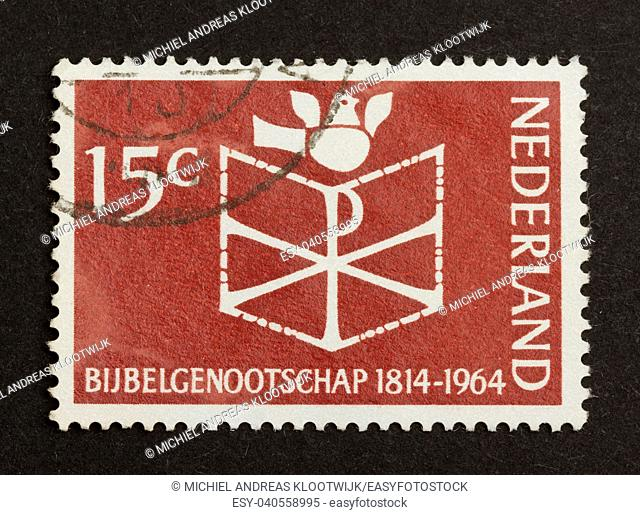 HOLLAND - CIRCA 1960: Stamp printed in the Netherlands shows a bible and a bird, circa 1960