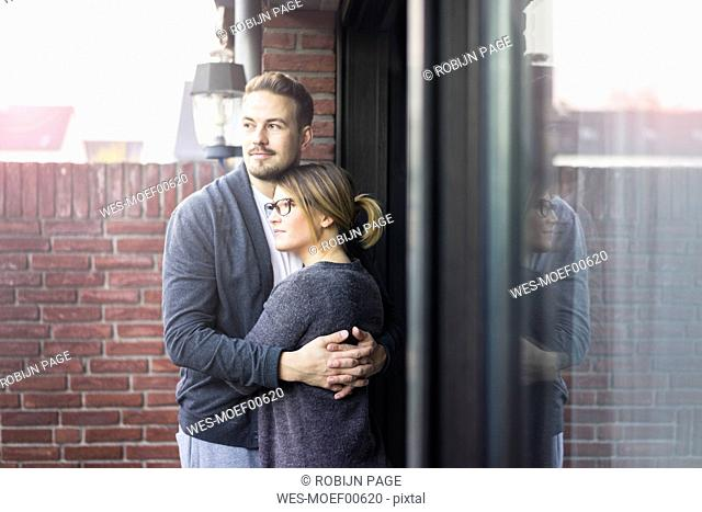 Couple embracing on terrace at home