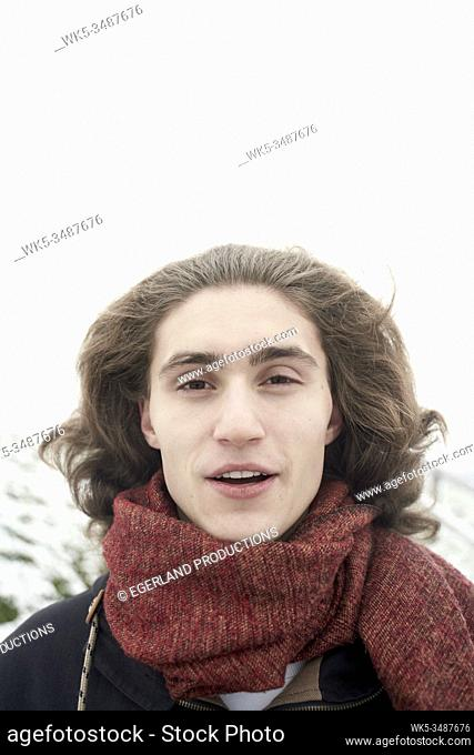 young man with long hairs
