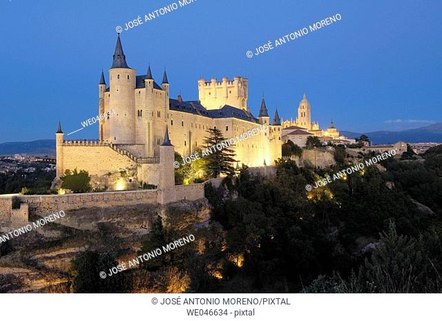 Alcazar fortress and cathedral in background at night, Segovia. Castilla-León, Spain