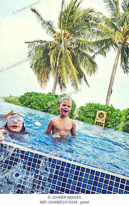 Boy and girl in swimming-pool