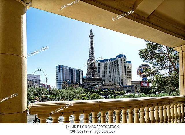Looking at the 'Strip' of Las Vegas, NV, from the Bellagio Hotel. Paris Hotel and Model Eiffel Tower in the Background